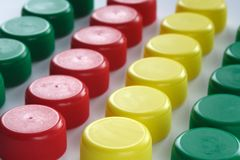 Plastic Caps. Red, yellow and green PET bottle caps Stock Images