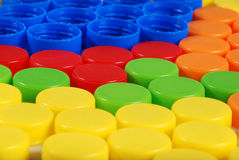 Plastic caps. A lot of plastic caps - blue, red, orange, green, yellow Royalty Free Stock Photography