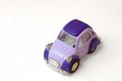 Plastic car. Little violet car toy like a 2cv Stock Image
