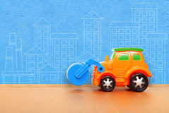 Plastic car on the floor Royalty Free Stock Photography