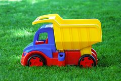 Plastic car on the grass Stock Images
