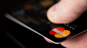 Mastercard in hand Stock Photos
