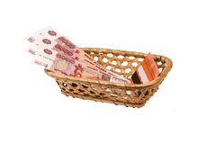 Plastic card and money in a wattled bast basket. Social plastic card and money in a wattled bast basket on a white background Stock Photography
