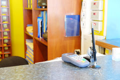 Plastic card reader on a reception table Stock Images