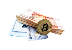 Plastic card of Sberbank and bitcoin coin Stock Photography