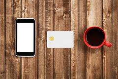 Plastic card, smartphone and coffee cup Royalty Free Stock Photos