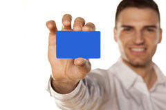 Plastic card. Smiling attractive young man, holding a plastic card in his hand Royalty Free Stock Images
