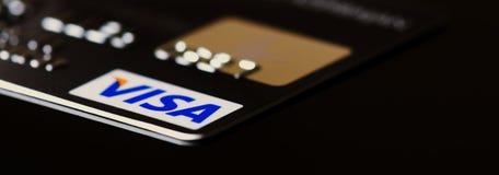 VISA card. Plastic card VISA on black background Royalty Free Stock Photography