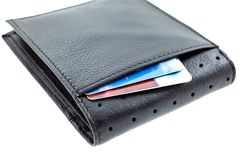 Plastic cards in a black leather wallet Royalty Free Stock Images