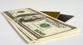 Plastic cards and money. Credit cards and dollars on a white background Stock Photo