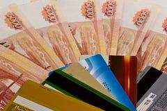 Plastic cards on money background Stock Photo