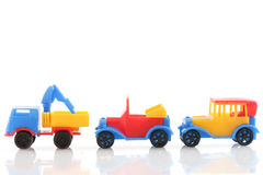 Plastic cars. Colorful plastic cars in blue red and yellow Stock Photography