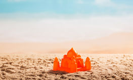 Plastic Castle in the sand on against sea. stock images
