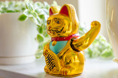 Plastic cat waves it`s hand. For luck royalty free stock photos