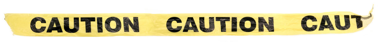 Plastic caution tape. Yellow plastic caution tape with white background stock image