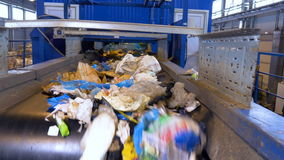 Plastic, cellophane trash on a conveyor at a recycling plant. No people. 4K stock footage