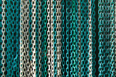 Plastic chain background texture. Hanging green chain background texture Stock Image
