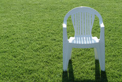 Plastic chair on green Stock Image