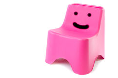 Plastic chair isolated on white. Happy face Pink plastic chair isolated on white background Stock Photos