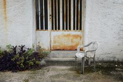 Chair in abandoned house yard stock image