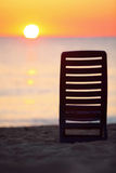 Plastic chair stands on beach near sea Royalty Free Stock Images