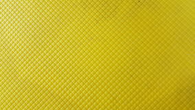 Plastic chair surface. Texture of  yellow plastic chair surface Stock Photo
