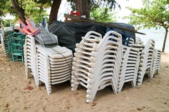 Plastic chair and table and umbrella had pack of group when forc. Ast of storm prediction and heavy wind or high level wave Stock Photo