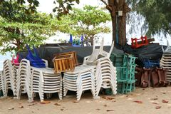 Plastic chair and table and umbrella had pack of group when forc. Plastic chair and table and umbrella had pack of group when forecast of storm prediction Royalty Free Stock Images
