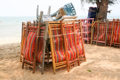 Plastic chair and table and umbrella had pack of group when forc. Plastic chair and table and umbrella had pack of group when forecast of storm prediction Royalty Free Stock Photo