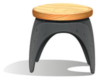 A plastic chair with a wooden seat Stock Image