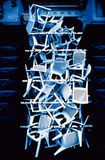 Plastic Chairs. Stacked in archway, photographed on color infra red film(grainy Royalty Free Stock Image