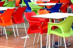Plastic Chairs. And tables at fast food restaurant Stock Photos