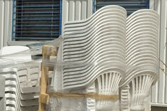 Plastic chairs. Chairs piled up in remodeling construction store Stock Photos