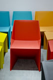 Plastic chairs by red, blue, orange colors Stock Images