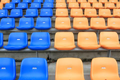 Plastic chairs in stadium. Royalty Free Stock Image