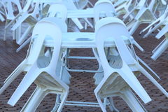 Plastic chairs and tables on a rainy day. A picnic area with white plastic tables and chairs - abandoned on a rainy day royalty free stock image