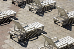 Plastic chaise. On sun by the hotel pool stock photos