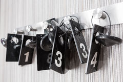 Plastic checks from fitting room. Black plastic check badges with white numbers on from clothes store fitting room Stock Images