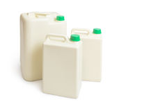 Plastic chemical gallon containers with green cap Stock Photography