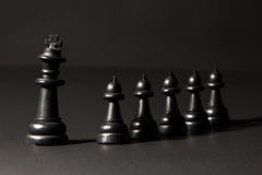 Plastic chess pieces Stock Images