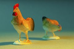 Plastic chickens. A close up of a plastic rooster and hen Stock Photos