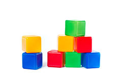 Plastic children's colored cubes Stock Photos