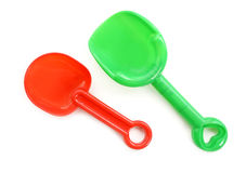 Plastic children's toy rake for the sandbox isolated on white background. Stock Image