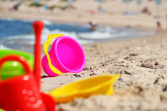 Plastic children toys on the beach Royalty Free Stock Photo