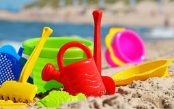 Plastic children toys on the beach Stock Image