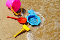 Plastic children toys on the beach Stock Photography