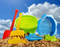 Plastic children toys over the blue sky Stock Image