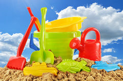 Plastic children toys over the blue sky Royalty Free Stock Photos