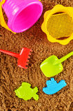 Plastic children toys for playing in sandpit or on a beach Royalty Free Stock Photo