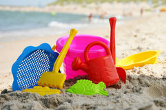 Plastic children toys on the sand beach Stock Photography